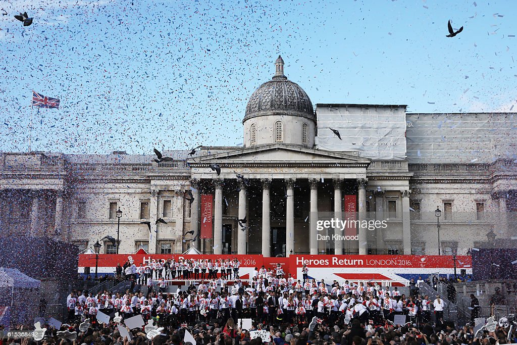 Confetti is released as spectators watch on as Athletes assemble during the Olympics & Paralympics Team GB - Rio 2016 Victory Parade at Trafalgar Square on October 18, 2016 in London, England.