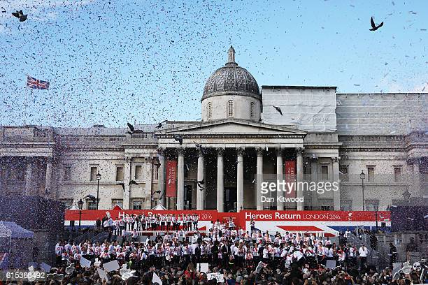 Confetti is released as spectators watch on as Athletes assemble during the Olympics Paralympics Team GB Rio 2016 Victory Parade at Trafalgar Square...