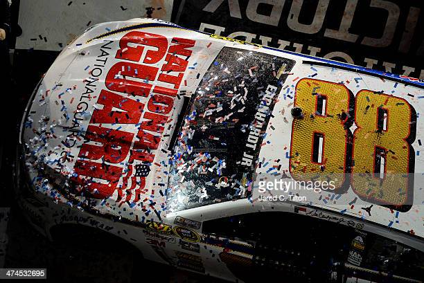 Confetti is seen on the car of Dale Earnhardt Jr driver of the National Guard Chevrolet in Victory Lane after he won the NASCAR Sprint Cup Series...