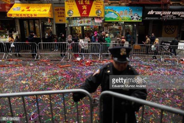 Confetti is seen on the ground as people take part in the Chinese Lunar New Year parade in Chinatown on February 25 2018 in New York City The Chinese...