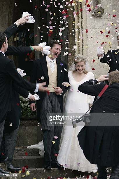 Confetti is thrown at the bride and groom Laura ParkerBowles and Harry Lopes at their wedding ceremony at St Cyriac's Church Lacock on May 6 2006 in...