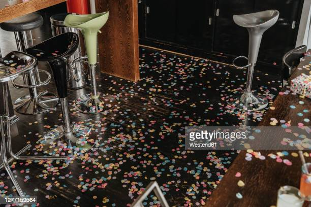 confetti on floor at home after party - messy house after party stock pictures, royalty-free photos & images