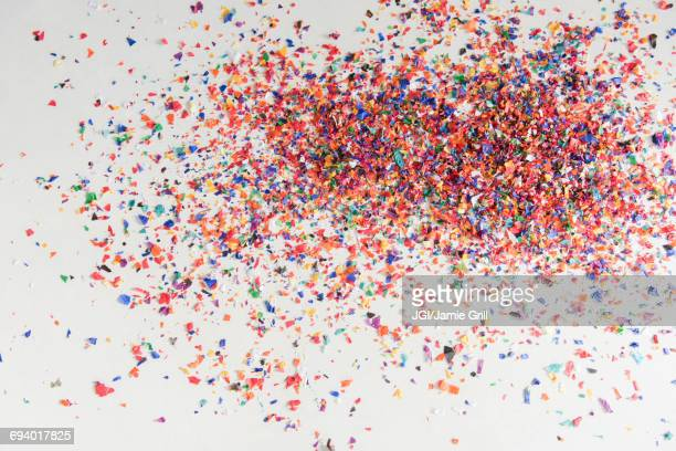 confetti on white floor - fun background stock pictures, royalty-free photos & images