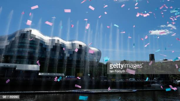 Confetti rains down after being fired by cannons as a water fountain art installation displays in the middle of the River Tyne on the launch day of...