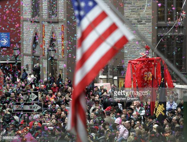 Confetti rains down on the huge crowd along Mott Street during the Chinese New Year celebration January 29 2006 in the Chinatown neighborhood of New...
