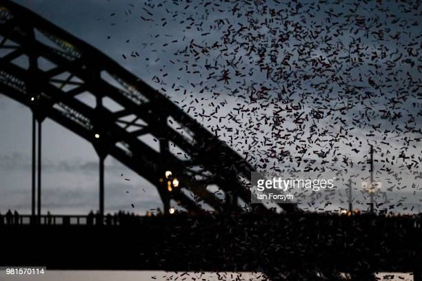 Confetti rains down on visitors in front of the Tyne Bridge during the opening ceremony of the Great Exhibition of the North on June 22, 2018 in...