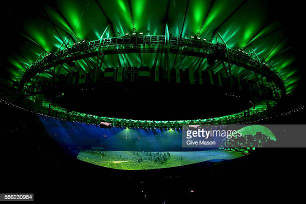Confetti shoots from Olympic Rings on the stage during the Opening Ceremony of the Rio 2016 Olympic Games at Maracana Stadium on August 5 2016 in Rio...