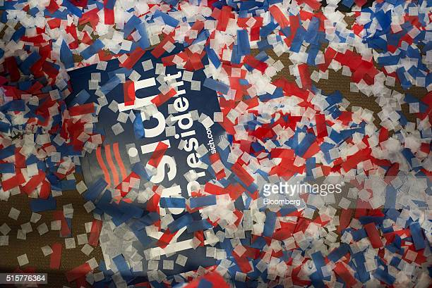 Confetti sits on top of a sign in support of John Kasich governor of Ohio and 2016 Republican presidential candidate after a campaign event in Berea...