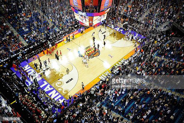 Confetti starts to fall as the Connecticut Huskies defeat the Louisville Cardinals during the 2013 NCAA Women's Final Four Championship at New...