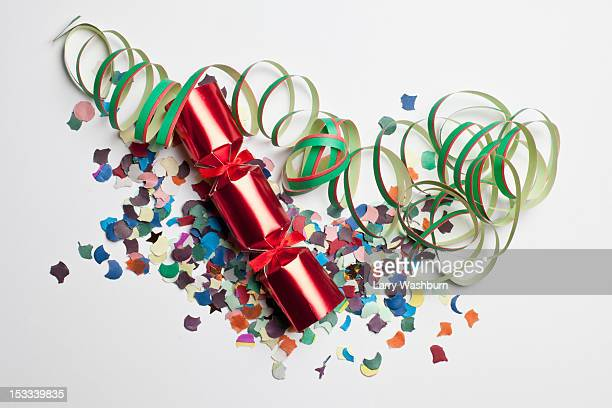 confetti, streamers and a christmas cracker - クリスマスクラッカー ストックフォトと画像