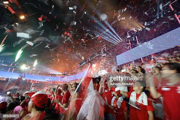 Confettis fill the sky during the National Day Parade at Padang on August 9 2015 in Singapore Singapore is celebrating her 50th year of independence...