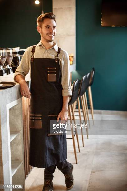 confidant young bartender - apron stock pictures, royalty-free photos & images
