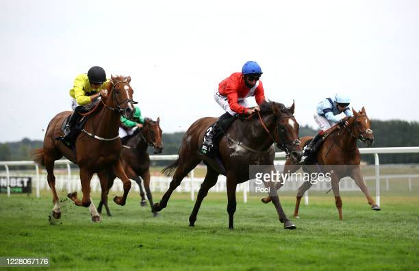 Confide ridden by jockey Daniel Tudhope on their way to winning the Unibet Extra Places Every Day Handicap race at Newbury Racecourse on August 16...