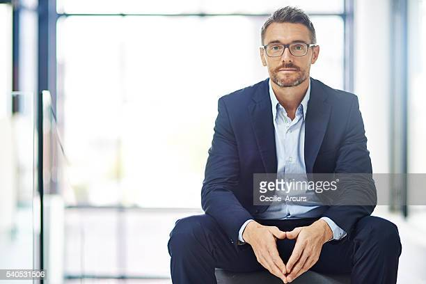 confidence is key to conveying a successful business image - businessman stock pictures, royalty-free photos & images