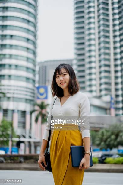 confidence young asian woman holding digital tablet - kuala lumpur stock pictures, royalty-free photos & images