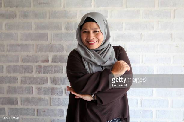 a confident adult muslim woman in hijab - religious veil stock pictures, royalty-free photos & images
