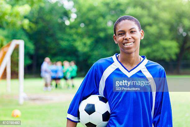 Confident African American athlete with soccer ball