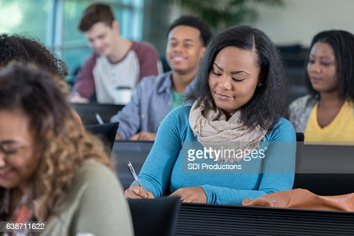 Confident African American College Student Takes Notes Stock Photo