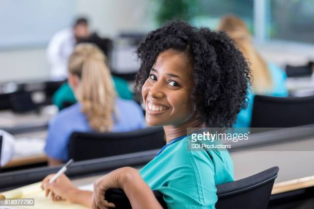Confident African American female medical student during class