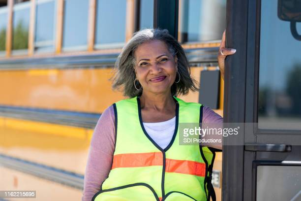 confident african american school bus driver - school bus stock pictures, royalty-free photos & images