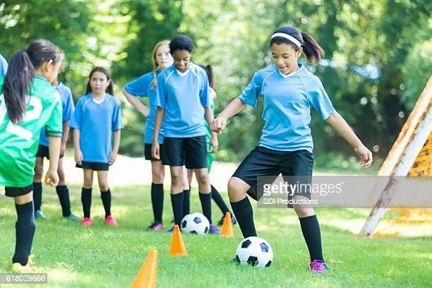 Confident African American soccer player practices with team