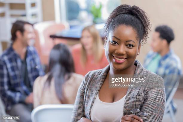 confident african american woman attends support group - psychologist stock photos and pictures