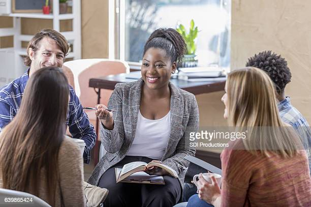 confident african american woman leads bible study - church stock pictures, royalty-free photos & images