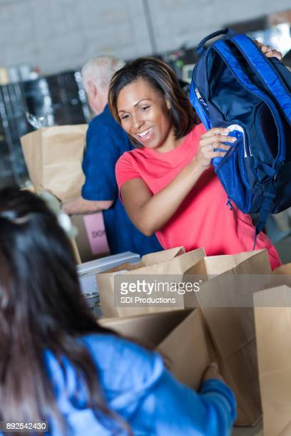 Confident African American woman volunteering during clothing drive