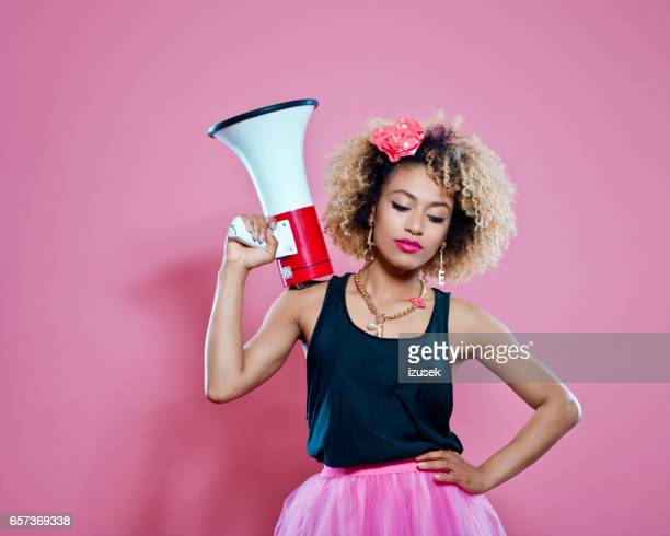 Confident afro woman holding megaphone