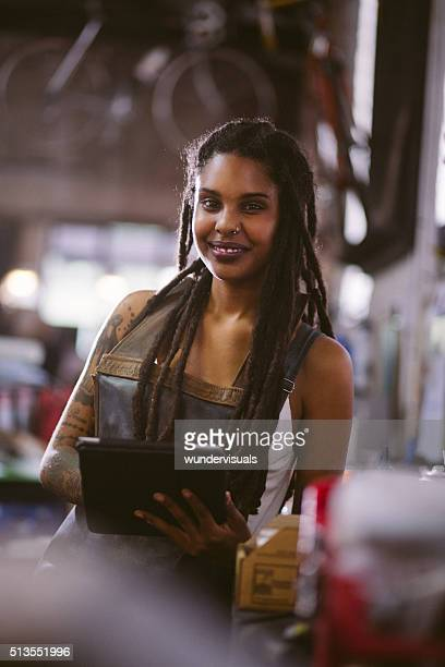 Confident afro-american craftswoman with a digital tablet in her