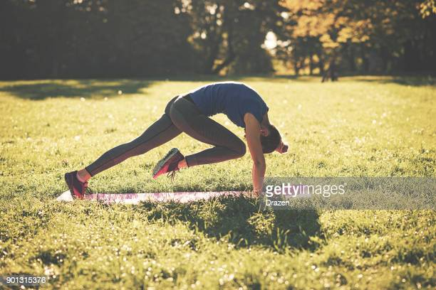Confident and good looking woman exercising outdoors