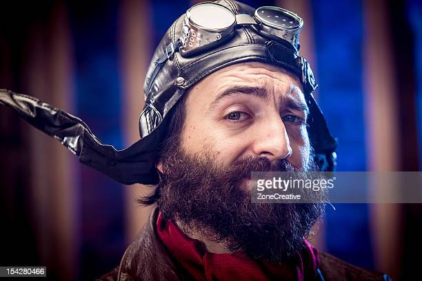 confident and proud old time pilot portrait - aviation hat stock photos and pictures