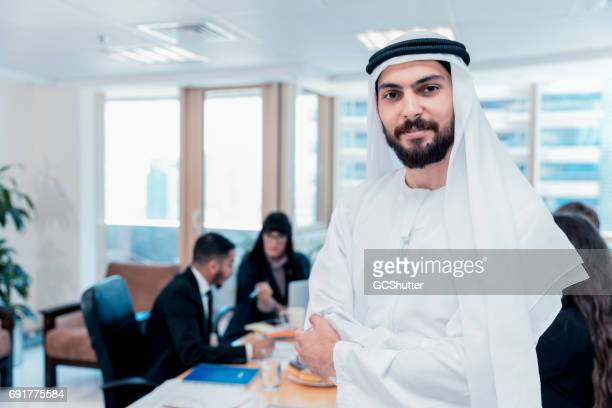confident arab businessman looking at the camera - saudi stock pictures, royalty-free photos & images