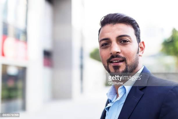 Confident Arab Businessman smiling at the camera