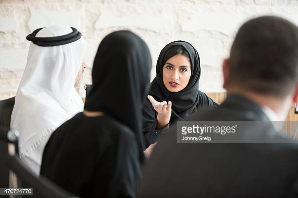 confident arab businesswoman in business meeting - middle east stock pictures, royalty-free photos & images