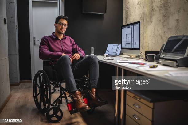 confident architect with differing abilities - assistive technology stock photos and pictures