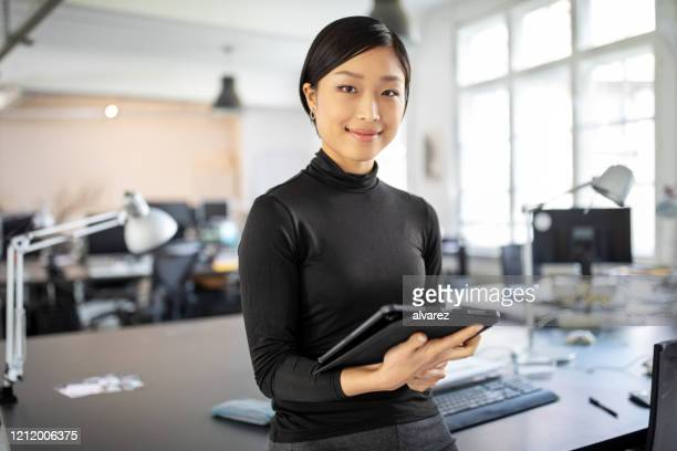 confident asian businesswoman in office - leadership stock pictures, royalty-free photos & images