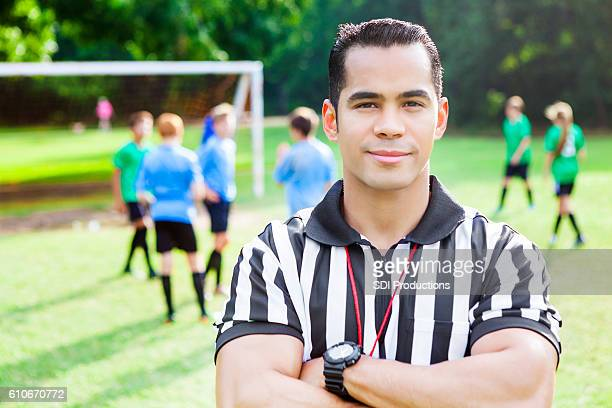 Confident athlete referee at soccer game