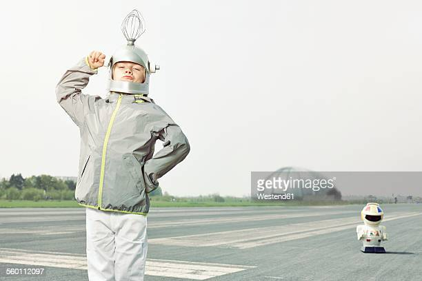 Confident boy dressed up as spaceman