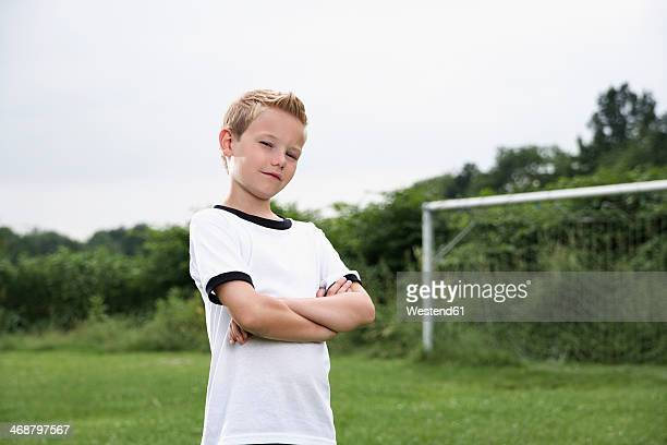 Confident boy in soccer jersey