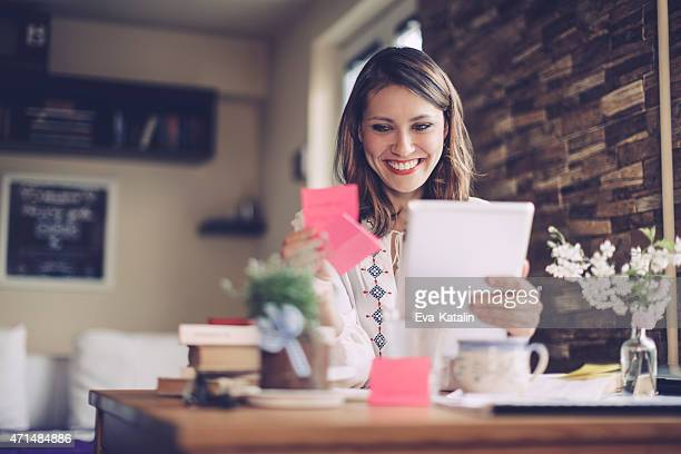 Confident, brunette businesswoman working at home