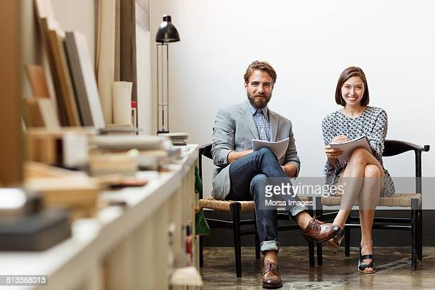 Confident business colleagues sitting in office