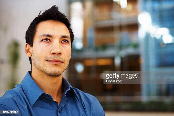 Confident business man in blue shirt