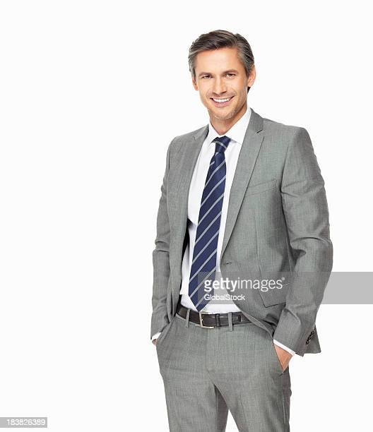 Confident business man with hands in pockets