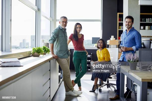 confident business people in office - four people stock pictures, royalty-free photos & images