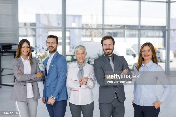 Confident business people posing for camera indoors