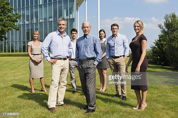 Confident Business People Standing At Lawn