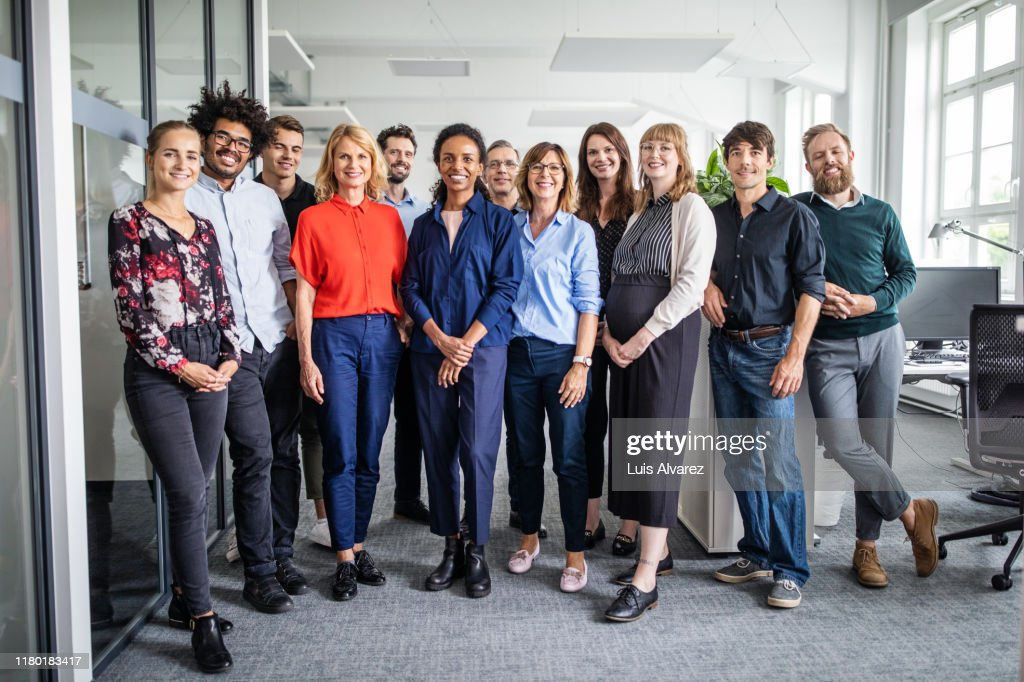 Confident business professionals in creative office : Stock-Foto