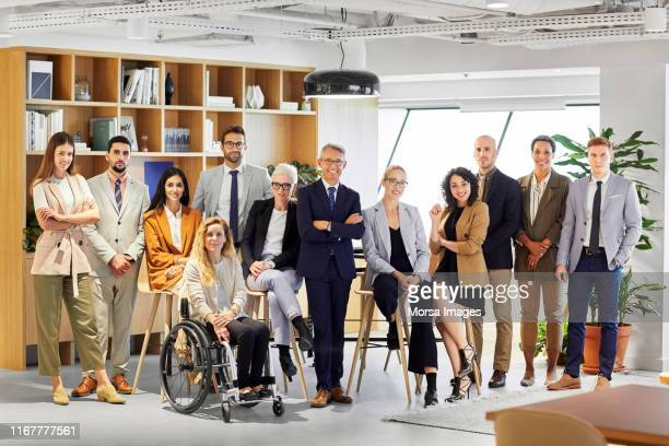 confident business professionals in office - persons with disabilities ストックフォトと画像