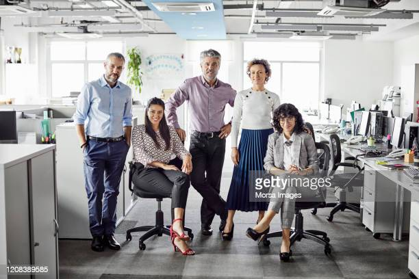 confident business team at coworking office - five people stock pictures, royalty-free photos & images